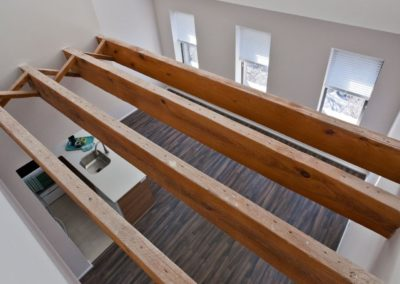 Two-story loft apartment in Center City with wood beam ceilings.