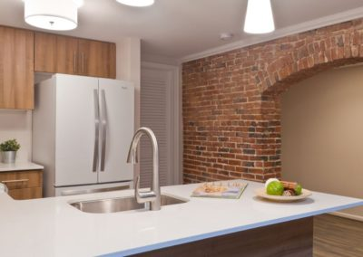 Exposed brick arch pass-through from kitchen to dining room at Trinity Row in Center City.
